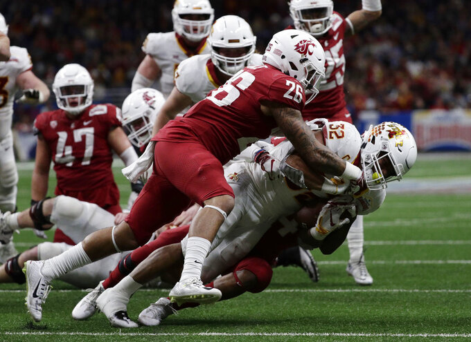 Iowa State running back David Montgomery (32) is hit by Washington State defensive back Hunter Dale (26) and another defender, partially obscure, during the second half of the Alamo Bowl NCAA college football game Friday, Dec. 28, 2018, in San Antonio. (AP Photo/Eric Gay)