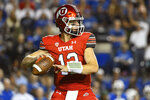 Utah quarterback Charlie Brewer (12) looks for a pass during the first half of an NCAA college football game against Brigham Young Saturday, Sept. 11, 2021, in Provo, Utah. (AP Photo/Alex Goodlett)