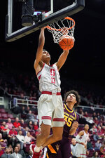 Stanford forward Oscar da Silva (13) slam dunks against Arizona State forward Taeshon Cherry (35) during the first half of an NCAA college basketball game in Stanford, Calif., Saturday, Jan. 12, 2019. (AP Photo/Tony Avelar)