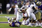 California's Damien Moore (28) is brought down on a carry by Washington's Kyler Gordon in the first half of an NCAA college football game Saturday, Sept. 25, 2021, in Seattle. (AP Photo/Elaine Thompson)