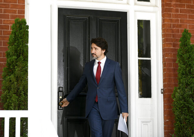Prime Minister Justin Trudeau arrives for a news conference on the COVID-19 pandemic outside his residence at Rideau Cottage in Ottawa, Thursday, June 18, 2020. (Justin Tang/The Canadian Press via AP)