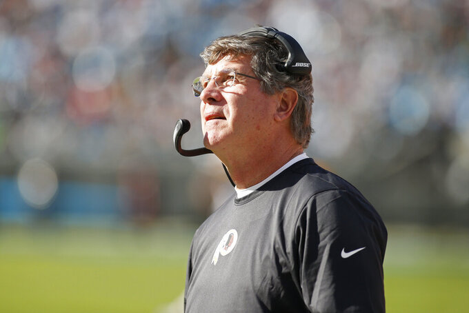 Washington Redskins head coach Bill Callahan looks on during the first half of an NFL football game against the Carolina Panthers in Charlotte, N.C., Sunday, Dec. 1, 2019. (AP Photo/Brian Blanco)