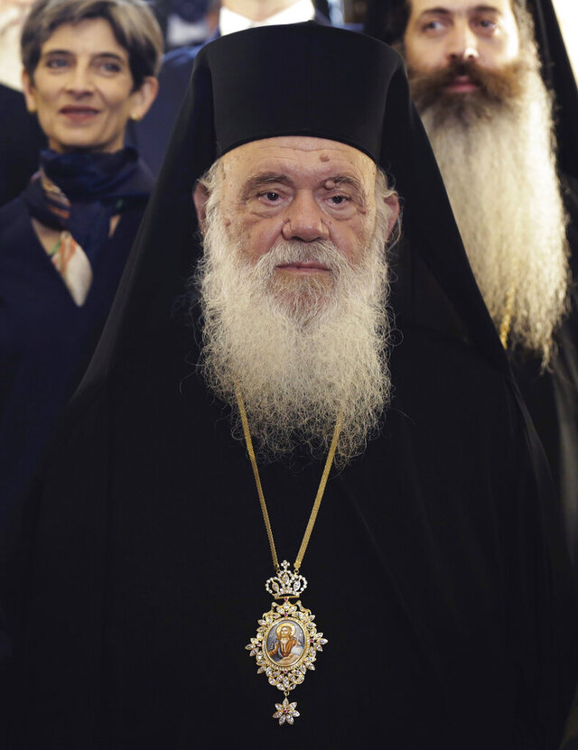 FILE - In this May 10, 2018, file photo, Greece's Orthodox Church Archbishop Ieronymos poses during the visit of Britain's Prince Charles in Athens. The head of the Orthodox Church of Greece, Archbishop Ieronymos, has been hospitalized after being diagnosed with COVID-19, a leading Athens hospital said Thursday, Nov. 19, 2020. (AP Photo/Petros Giannakouris, File)