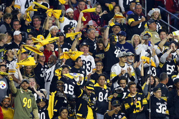 Pittsburgh Steelers fans cheer during the second half of an NFL football game against the Arizona Cardinals, Sunday, Dec. 8, 2019, in Glendale, Ariz. (AP Photo/Ross D. Franklin)