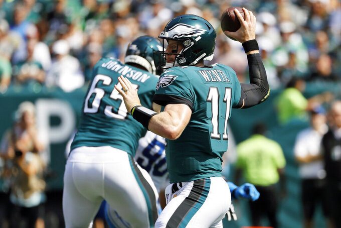 Philadelphia Eagles' Carson Wentz throws a pass during the first half of an NFL football game against the Detroit Lions, Sunday, Sept. 22, 2019, in Philadelphia. (AP Photo/Michael Perez)