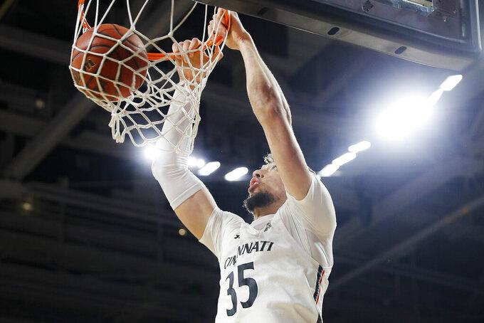 Cincinnati's Jaume Sorolla dunks during the first half of the team's NCAA college basketball game against Alabama A&M, Thursday, Nov. 14, 2019, in Cincinnati. (AP Photo/John Minchillo)