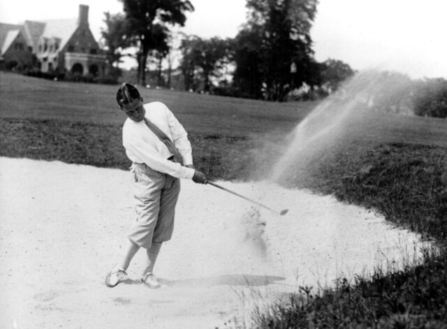 FILE - This June 27, 1929 file photo, Bobby Jones makes a shot out of a sand trap as the 33rd U.S. Open Golf championship at the Winged Foot Golf Club at Mamaroneck, N.Y.  (AP Photo, File)