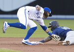 Toronto Blue Jays' Bo Bichette puts the tag on Seattle Mariners' Tim Lopes for the out on an attempted steal of second during the second inning of a baseball game Friday, Aug. 16, 2019, in Toronto. (Fred Thornhill/The Canadian Press via AP)