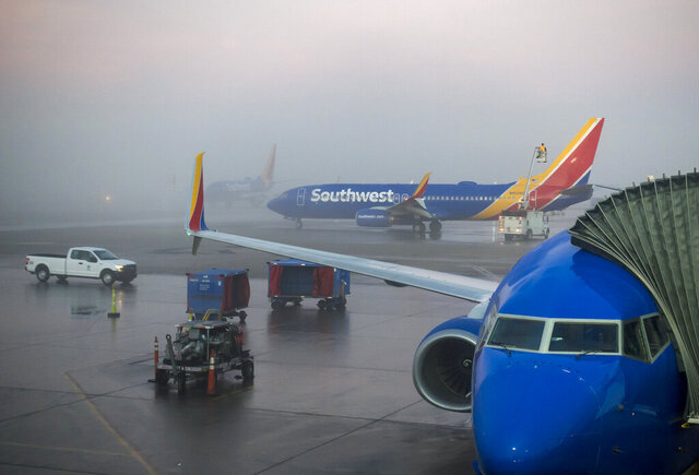 Foggy weather delays Southwest Airlines flights Tuesday, Dec. 24, 2019 at Midway International Airport. Dense fog caused flight delays and some cancellations at Chicago's O'Hare and Midway international airports early on Christmas Eve — one of the busiest travel days of the holiday season. (Brian Cassella/Chicago Tribune via AP)
