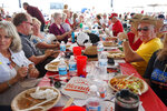 People attend the Morning in Nevada PAC's Basque Fry at Corley Ranch, Saturday, Aug. 14, 2021, in Gardnerville, Nev. U.S. Sen. Tom Cotton told a crowd of about 4,000 Nevada Republicans that Adam Laxalt planned to run for the U.S. Senate against Democrat Catherine Cortez Masto. (AP Photo/Sam Metz)