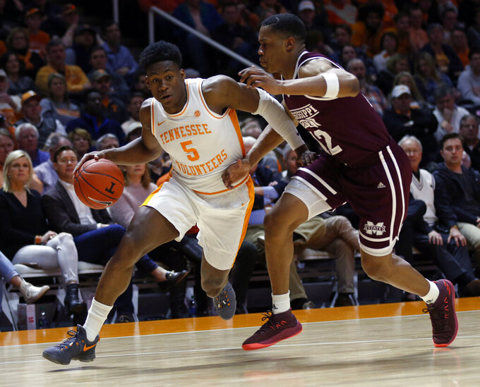 Tennessee guard Admiral Schofield (5) drives as he's defended by Mississippi State guard Robert Woodard (12) during the first half of an NCAA college basketball game Tuesday, March 5, 2019, in Knoxville, Tenn. (AP Photo/Wade Payne)