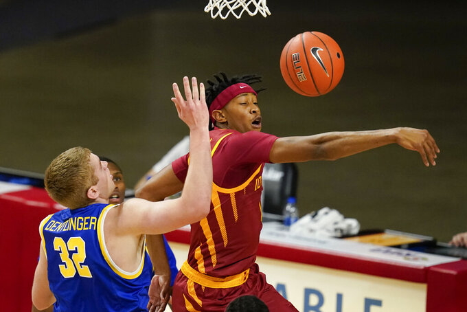 Iowa State forward Javan Johnson blocks a shot by South Dakota State forward Matt Dentlinger (32) during the first half of an NCAA college basketball game, Wednesday, Dec. 2, 2020, in Ames, Iowa. (AP Photo/Charlie Neibergall)