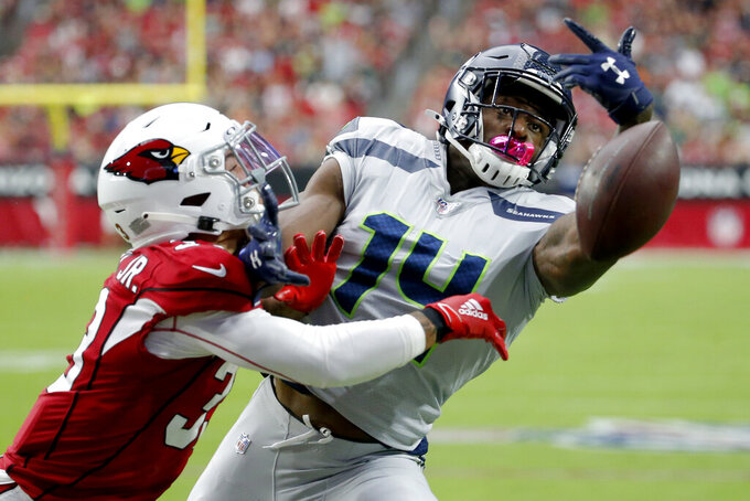 Arizona Cardinals cornerback Byron Murphy (33) breaks up a pass intended for Seattle Seahawks wide receiver D.K. Metcalf (14) during the first half of an NFL football game, Sunday, Sept. 29, 2019, in Glendale, Ariz. (AP Photo/Rick Scuteri)