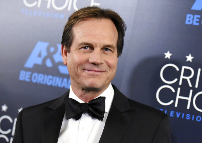 FILE - In this May 31, 2015 file photo, Bill Paxton arrives at the Critics' Choice Television Awards at the Beverly Hilton Hotel in Beverly Hills, Calif. Paxton's family has filed a wrongful death lawsuit against Cedars-Sinai Medical Center in Los Angeles, and the surgeon who performed the actor's heart surgery, shortly before he died on Feb. 25, 2017. The suit filed Friday, Feb. 9, 2018 alleges the surgeon used a