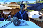 A Baduy tribesman casts his ballot at a polling station in Kanekes village, Indonesia, Wednesday, April 17, 2019. Indonesian President Joko Widodo is on track to win a second term, preliminary election results showed Wednesday, in apparent victory for moderation over the ultra-nationalistic rhetoric of his rival Prabowo Subianto. (AP Photo/Rangga)