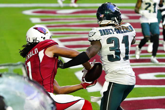 Arizona Cardinals wide receiver Larry Fitzgerald (11) pulls in a touchdown catch as Philadelphia Eagles cornerback Nickell Robey-Coleman (31) defends during the first half of an NFL football game, Sunday, Dec. 20, 2020, in Glendale, Ariz. (AP Photo/Rick Scuteri)