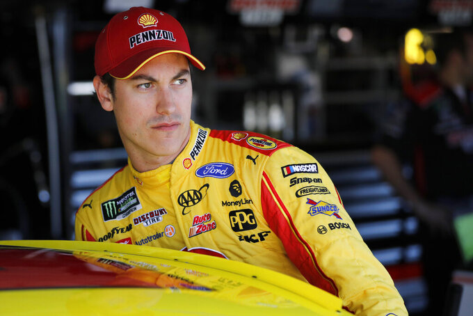 FILE - In this Oct. 18, 2019, file photo, NASCAR driver Joey Logano climbs into his car to practice for a Cup Series auto race at Kansas Speedway in Kansas City, Kan. Logano has established a $1 Million COVID-19 Response and Recovery Fund. (AP Photo/Colin E. Braley, File)