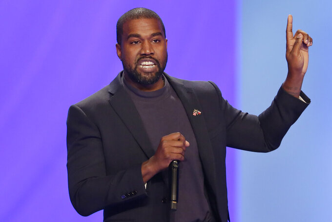 FILE - In this Sunday, Nov. 17, 2019, file photo, Kanye West answers questions during a service at Lakewood Church, in Houston. On Friday, Oct. 16, 2020, The Associated Press reported on stories circulating online incorrectly asserting that election results in Kentucky show the rapper and independent presidential candidate is ahead of President Donald Trump and Democratic nominee Joe Biden in the presidential race. West tweeted mock election data that the AP provides to customers as part of routine testing ahead of elections. (AP Photo/Michael Wyke, File)