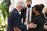 Former President Bill Clinton speaks with Atlanta Mayor Keisha Lance Bottoms during funeral services for Henry