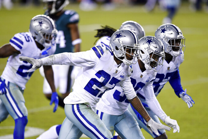 Dallas Cowboys' Trevon Diggs (27) celebrates with teammates after intercepting a pass during the second half of an NFL football game against the Philadelphia Eagles, Sunday, Nov. 1, 2020, in Philadelphia. (AP Photo/Derik Hamilton)