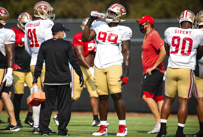 San Francisco 49ers defensive tackle Javon Kinlaw (99) breaks for a drink during NFL football training camp Friday, Aug. 21, 2020, in Santa Clara, Calif. (Xavier Mascareñas/The Sacramento Bee via AP)