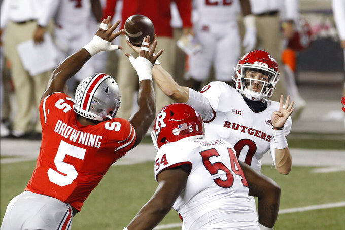 Rutgers quarterback Noah Vedral throws a pass against Ohio State during the first half of an NCAA college football game Saturday, Nov. 7, 2020, in Columbus, Ohio. (AP Photo/Jay LaPrete)