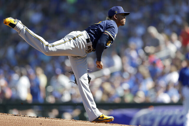 Milwaukee Brewers starting pitcher Freddy Peralta works against a Chicago Cubs batter during the first inning of a spring training baseball game Saturday, Feb. 29, 2020, in Mesa, Ariz. (AP Photo/Gregory Bull)