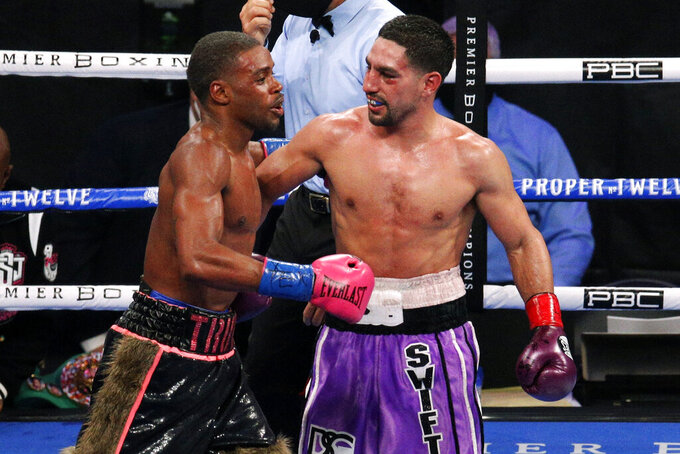 Errol Spence Jr. and Danny Garcia, right, talk after their WBC an IBF welterweight championship boxing bout in Arlington, Texas, Saturday, Dec. 5, 2020. Spence won the fight. (AP Photo/Brandon Wade)