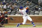 New York Mets' Pete Alonso hits a two-run double during the eighth inning of a baseball game against the Atlanta Braves, Sunday, June 30, 2019, in New York. (AP Photo/Kathy Willens)