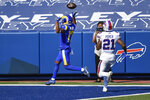 Los Angeles Rams wide receiver Robert Woods celebrates as he scores a touchdown in front of Buffalo Bills free safety Jordan Poyer (21) during the second half of an NFL football game Sunday, Aug. 26, 2018, in Orchard Park, N.Y. (AP Photo/Adrian Kraus)