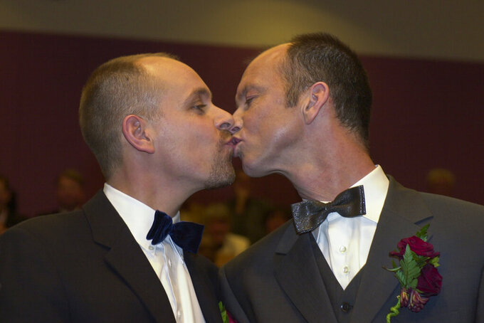 Gert Kasteel, left, and Dolf Pasker kiss after exchanging vows at Amsterdam's City Hall early Sunday, April 1, 2001. The pair was among four couples to get married under a new law which took effect April 1, 2001, the world's first such law allowing same-sex marriages with equal rights. Same-sex marriage is now legal in 28 countries, including most of Western Europe, as well as in the self-governing island of Taiwan. (AP Photo/Peter Dejong)