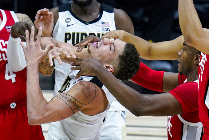 Purdue forward Mason Gillis (0) is fouled by Ohio State forward Seth Towns (31) in the second half of an NCAA college basketball game at the Big Ten Conference tournament in Indianapolis, Friday, March 12, 2021. Ohio State defeated Purdue 87-78 in overtime. (AP Photo/Michael Conroy)