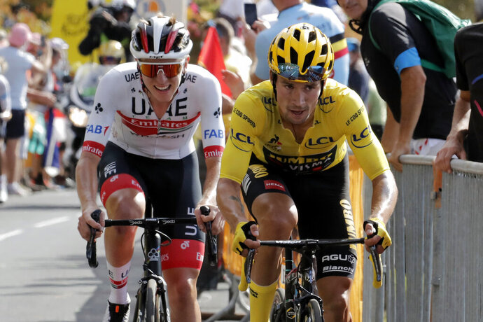 Slovenia's Primoz Roglic wearing the overall leader's yellow jersey and Slovenia's Tadej Pogacar ride during the stage 13 of the Tour de France cycling race over 191 kilometers from Chatel-Guyon to Puy Mary, Friday, Sept. 11, 2020. (AP Photo/Christophe Ena)