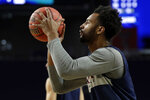 Virginia's Braxton Key warms up during a practice session for the semifinals of the Final Four NCAA college basketball tournament, Friday, April 5, 2019, in Minneapolis. (AP Photo/Jeff Roberson)
