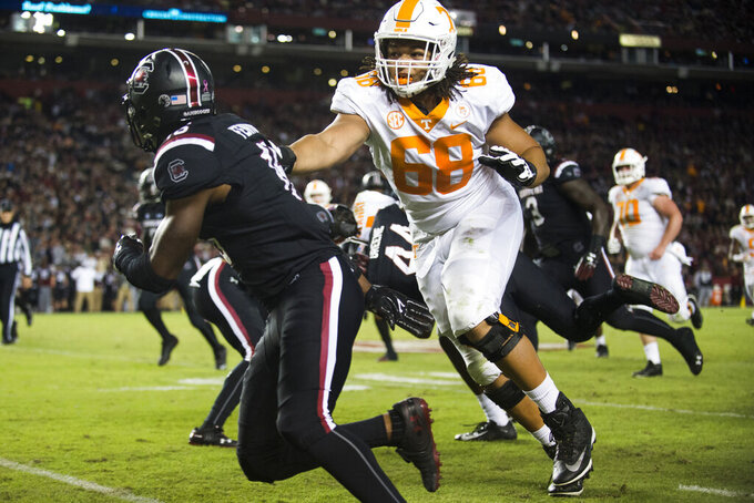In this Oct. 27, 2018, file photo, Tennessee tackle Marcus Tatum (68) plays against South Carolina during an NCAA college football game in Columbia, S.C. Tennessee's offensive linemen have taken plenty of lumps over the last two years from opposing pass rushers, the media and even their own fans. Now they're eager to take out their frustrations and change the narrative surrounding their recent results. (Calvin Mattheis/Knoxville News Sentinel via AP, File)