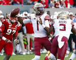 FILE - In this Nov. 3, 2018, file photo, Florida State's James Blackman (1) looks to pass during the first half of the team's NCAA college football game against North Carolina State in Raleigh, N.C. Blackman is in the driver's seat in the quarterback competition at Florida State. (AP Photo/Chris Seward, File)