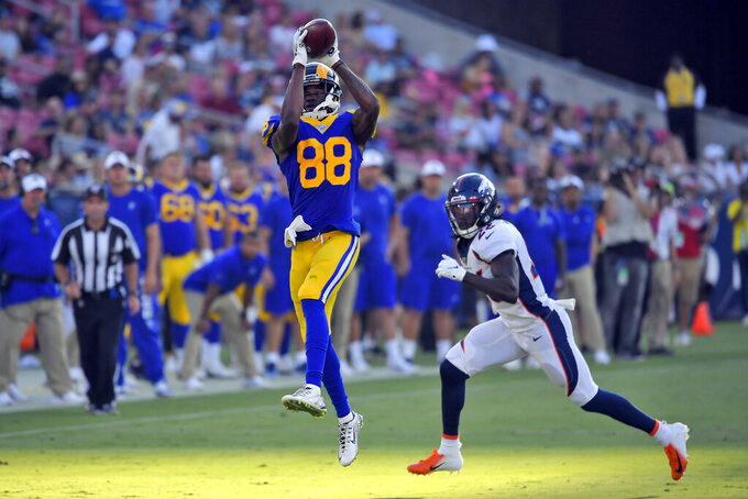 Los Angeles Rams wide receiver Michael Thomas, left, makes a catch next to Denver Broncos defensive back Kareem Jackson during the first half of an NFL preseason football game Saturday, Aug. 24, 2019, in Los Angeles. (AP Photo/Mark J. Terrill)