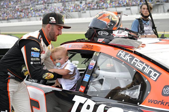 Austin Dillon sets his son, Ace, in his vehicle on pit road before a NASCAR Cup Series auto race at Daytona International Speedway, Saturday, Aug. 28, 2021, in Daytona Beach, Fla. (AP Photo/Phelan M. Ebenhack)