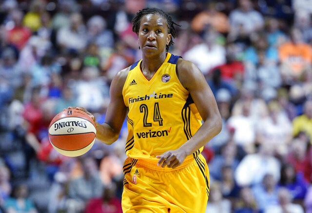 FILE - In this June 5, 2016, file photo, Indiana Fever's Tamika Catchings brings the ball up during the first half of a WNBA basketball game against the Connecticut Sun in Uncasville, Conn. Catchings is among 12 finalists announced Thursday, Jan. 9, for the Women's Basketball Hall of Fame Class of 2020.p (AP Photo/Jessica Hill, File)