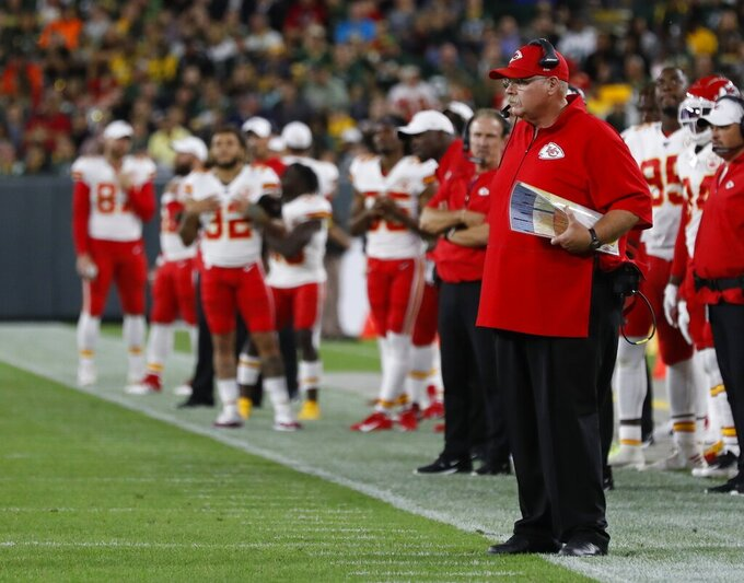 Kansas City Chiefs head coach Andy Reid watches during the first half of a preseason NFL football game against the Green Bay Packers Thursday, Aug. 29, 2019, in Green Bay, Wis. (AP Photo/Matt Ludtke)