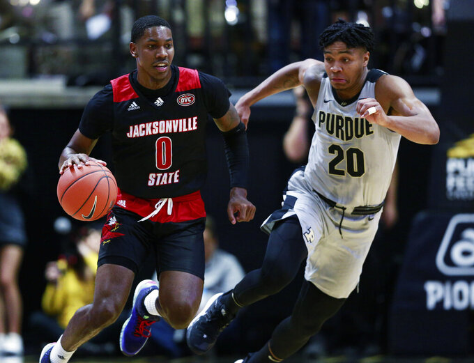 Jacksonville State guard Derrick Cook (0) dribbles the ball defended by Purdue guard Nojel Eastern during an NCAA college basketball game Saturday, Nov. 23, 2019, in West Lafayette, Ind. (AP Photo/R Brent Smith)