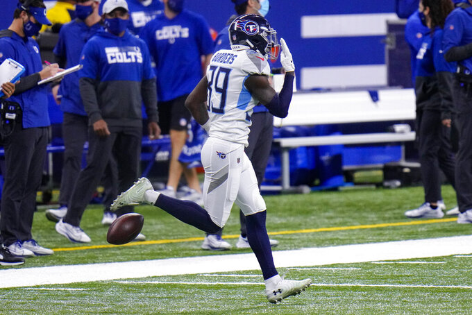 Tennessee Titans cornerback Breon Borders (39) celebrates an interception against the Indianapolis Colts in the second half of an NFL football game in Indianapolis, Sunday, Nov. 29, 2020. (AP Photo/AJ Mast)