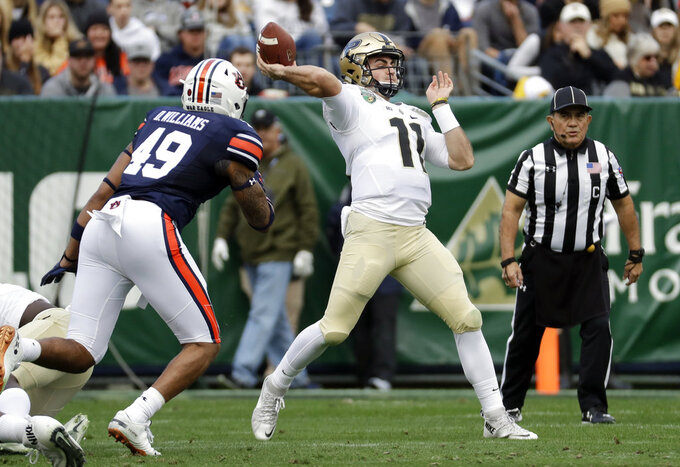 Purdue quarterback David Blough (11) passes as Auburn linebacker Darrell Williams (49) rushes in the first half of the Music City Bowl NCAA college football game Friday, Dec. 28, 2018, in Nashville, Tenn. (AP Photo/Mark Humphrey)