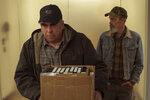 This image released by Focus Features shows Bill Camp, left,  and Jim Azelvandre in a scene from