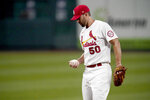 St. Louis Cardinals starting pitcher Adam Wainwright pauses on the mound after giving up a two-run home run to Cincinnati Reds' Joey Votto during the first inning of a baseball game Friday, Sept. 11, 2020, in St. Louis. (AP Photo/Jeff Roberson)