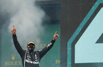 Mercedes driver Lewis Hamilton of Britain celebrates on the podium after winning the Turkish Formula One Grand Prix at the Istanbul Park circuit racetrack in Istanbul, Sunday, Nov. 15, 2020. (Murad Sezer/Pool via AP)