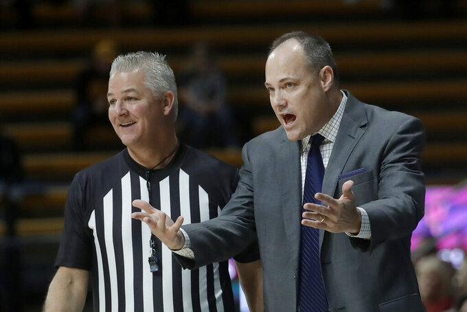 California coach Mark Fox, right, gestures next to an official during the first half of the team's NCAA college basketball game against Arizona State in Berkeley, Calif., Sunday, Feb. 16, 2020. (AP Photo/Jeff Chiu)