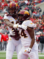 Minnesota running back Mohamed Ibrahim, right, celebrates his touchdown against Ohio State with teammate Rashod Bateman during the first half of an NCAA college football game Saturday, Oct. 13, 2018, in Columbus, Ohio. (AP Photo/Jay LaPrete)