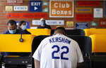 Los Angeles Dodgers fan Adam Tapia, 23, of Whittier, Calif., votes on Election Day at Dodger Stadium, Tuesday, Nov. 3, 2020, in Los Angeles. (AP Photo/Chris Pizzello)