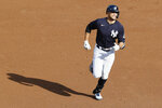 New York Yankees designated hitter Giancarlo Stanton runs the bases after hitting a solo home run off James Paxton during an intrasquad baseball game Wednesday, July 15, 2020, at Yankee Stadium in New York. (AP Photo/Kathy Willens)